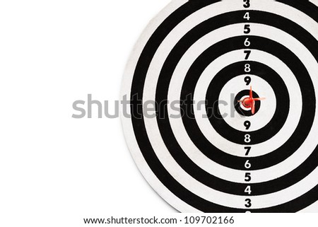 Red dart on red point of dartboard