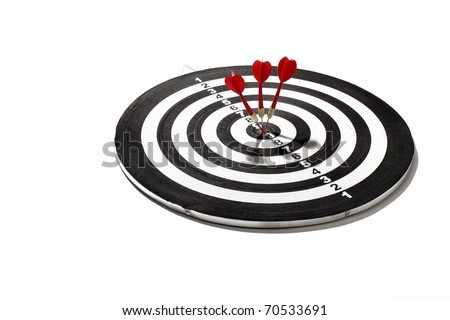 red darts smack in the center of the board - stock photo