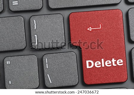 Red delete key on keyboard - stock photo