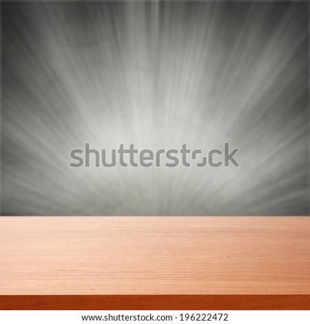 red desk of free space and gray wall with light  - stock photo