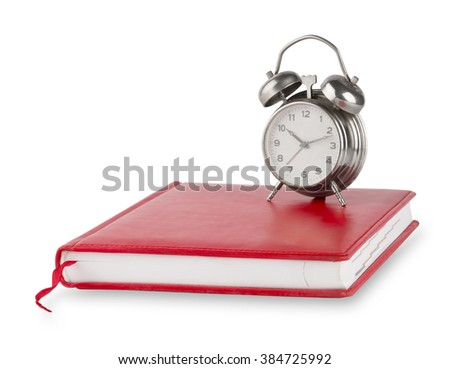 Red diary and old alarm clock isolated on white background - stock photo