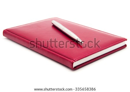 Red diary and pen on a white background - stock photo