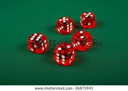 Red dice on casino table
