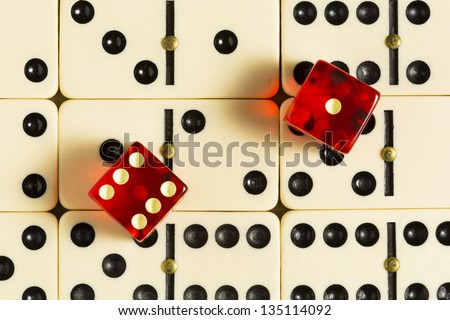 Red Dice On Dominoes