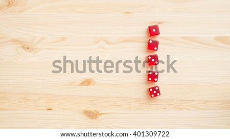 Red dice on wooden background. Concept of gambling, luck and chance. - stock photo