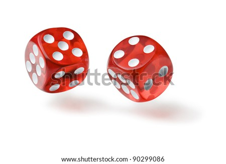 Red dices in midair on white background close up - stock photo
