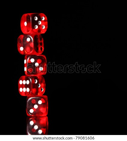 Red dices on black background - stock photo