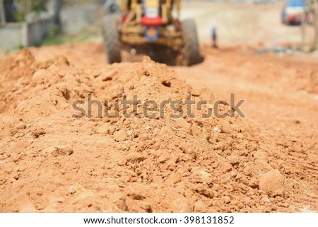 Red dirt (soil) background or texture.