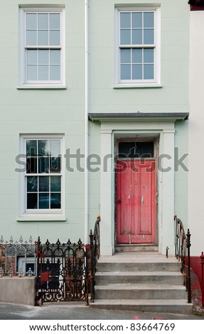 Red  door and window. A red door with ladder steps and windows.Guernsey
