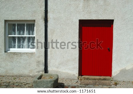 Red Door and Windows in a Scottish Cottage - stock photo