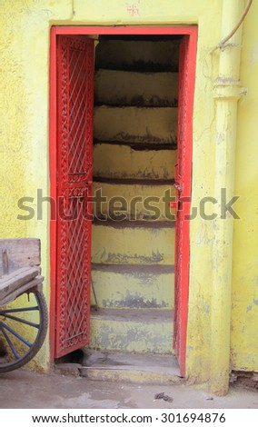 Red door and yellow wall, Delhi, India