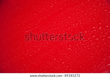 red door of car in a raining day - stock photo