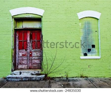 Red Door on Green Wall - stock photo