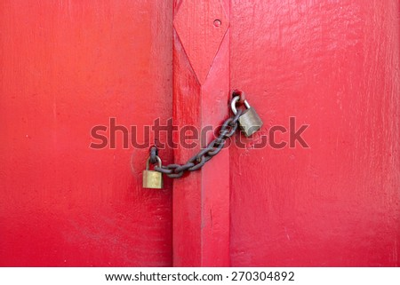 Red Door Wood  Lock by the chain - stock photo