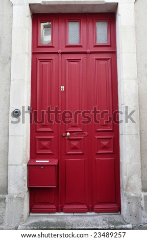 Red doorway on a building in France