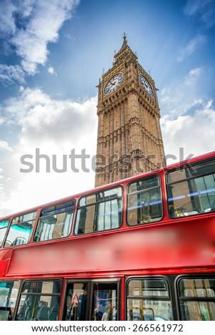 Red Double Decker Bus under Big Ben. London travel concept. - stock photo