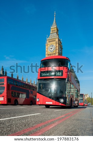 Red double-decker buses in front of Big Ben in London  - stock photo