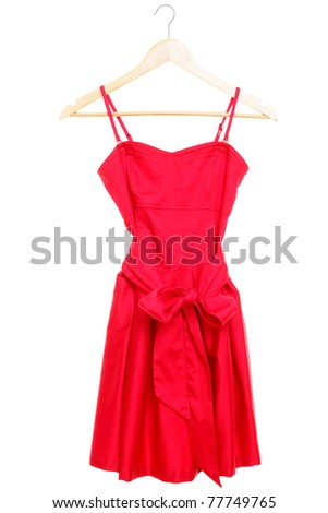 Red dress on hanger isolated on white background. - stock photo