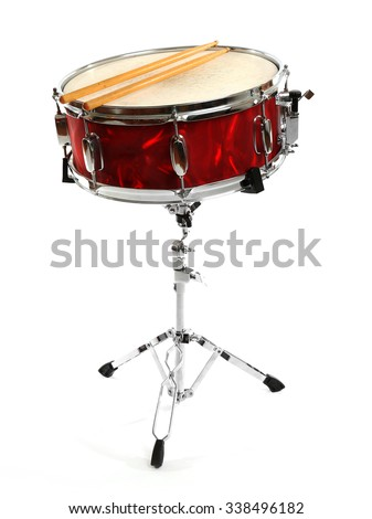 Red drum with drum sticks isolated on white background - stock photo