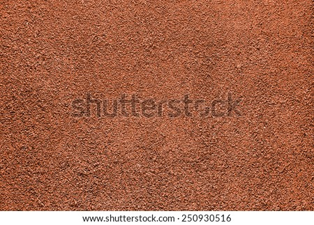 Red dry grungy clay tennis background texture.  - stock photo