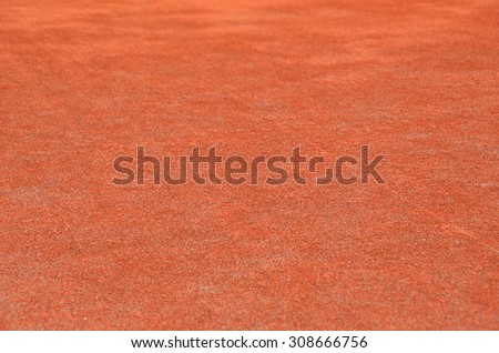 Red dry grungy clay tennis textured background  - stock photo