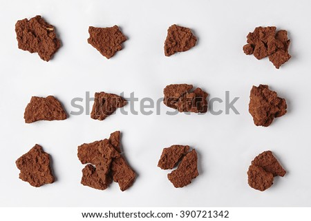 Red Dry Soil isolated on White Background. Pile of Dirt and Stones. Top View of a Heap of Ground. Close Up Macro View Collection - stock photo