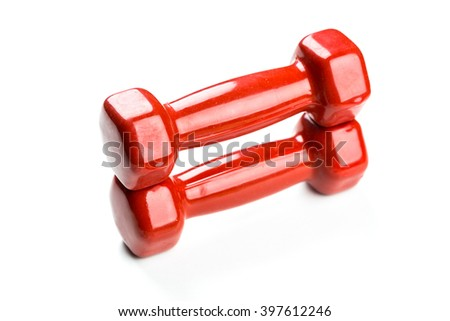 Red dumbbells isolated on white background - stock photo