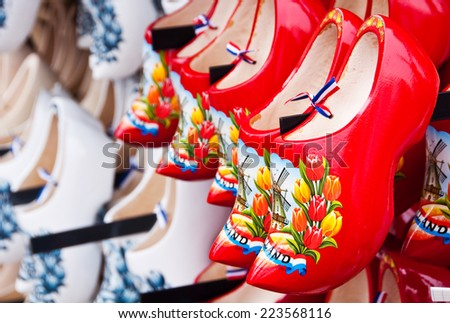 Red Dutch wooden shoes in Amsterdam shop - stock photo