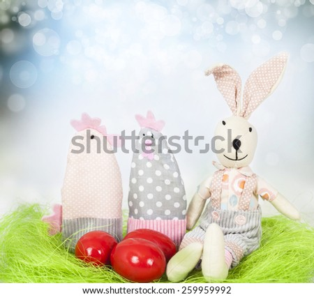 Red Easter eggs and decorations on fresh spring background - stock photo