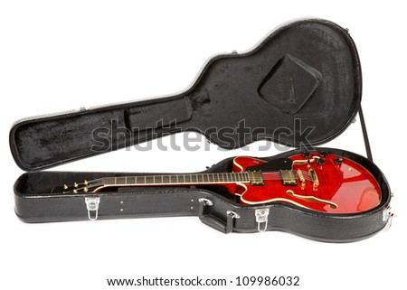 red electric semi-hollow guitar in hard case, isolated on white - stock photo