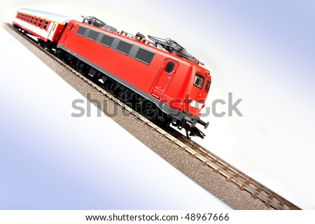 red electric train on blue backgorund - stock photo