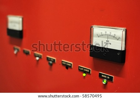 Red electricity meter showing voltage. For concepts such as electricity, energy, and industrial concepts. - stock photo