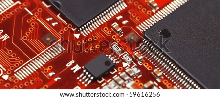 Red electronic board with components - stock photo