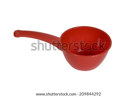 Red empty plastic scoop on white background.