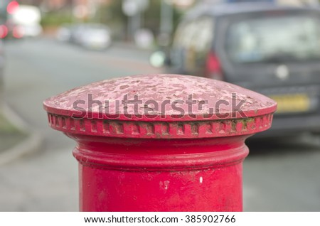 Red English pillar box or post box top on city space background. - stock photo