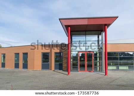 red entrance of a modern office building - stock photo