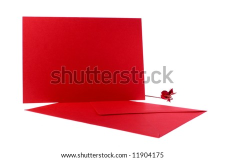 Red envelope and card with rose on white background. - stock photo
