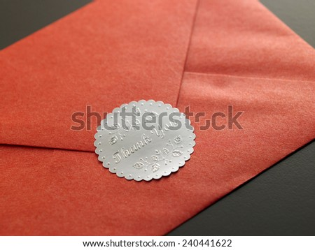 red envelope with tank you sticker on it - stock photo