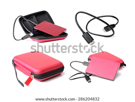 Red external hard drive with usb cable on the white background - stock photo