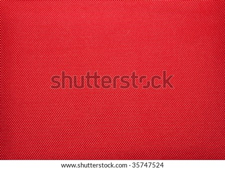 Red fabric as a background - stock photo