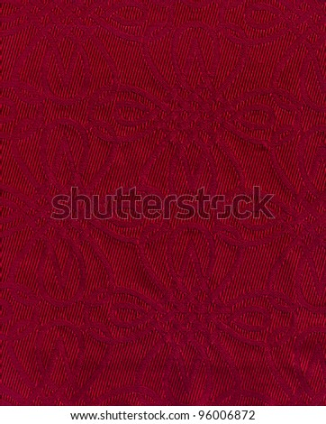 Red fabric background with classic ornament. - stock photo
