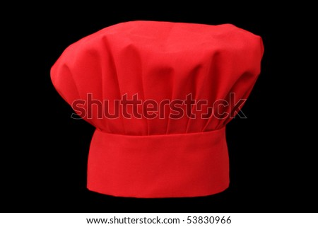 red fabric chief cook hat isolated on black background - stock photo