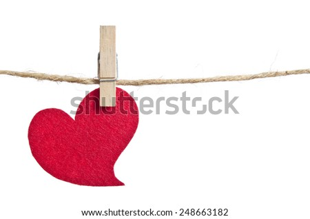 Red fabric hearts hanging on the clothesline . On white background - stock photo