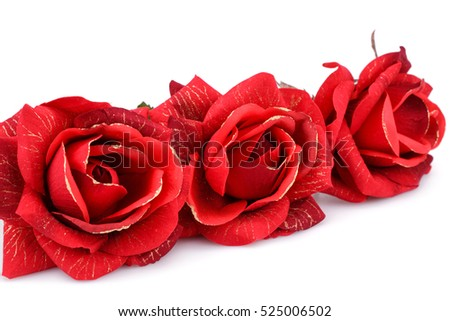 Red fabric roses isolated on white background.