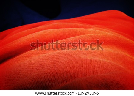 Red fabric textured abstract background. Close up. - stock photo