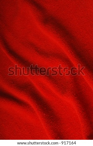 Red fabric with folds - stock photo