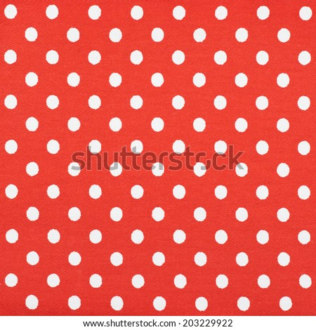 Red fabric with the white polka dots as a background texture composition - stock photo