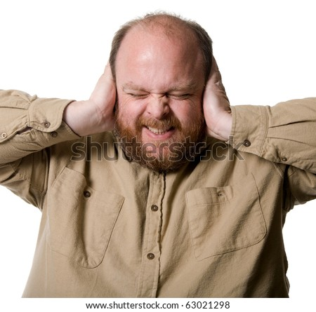 Red faced covering the ears. - stock photo