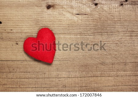 Red  felt heart on wooden background, Valentines Day background  - stock photo