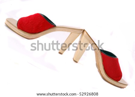 Red female shoes with a buckle on a white background